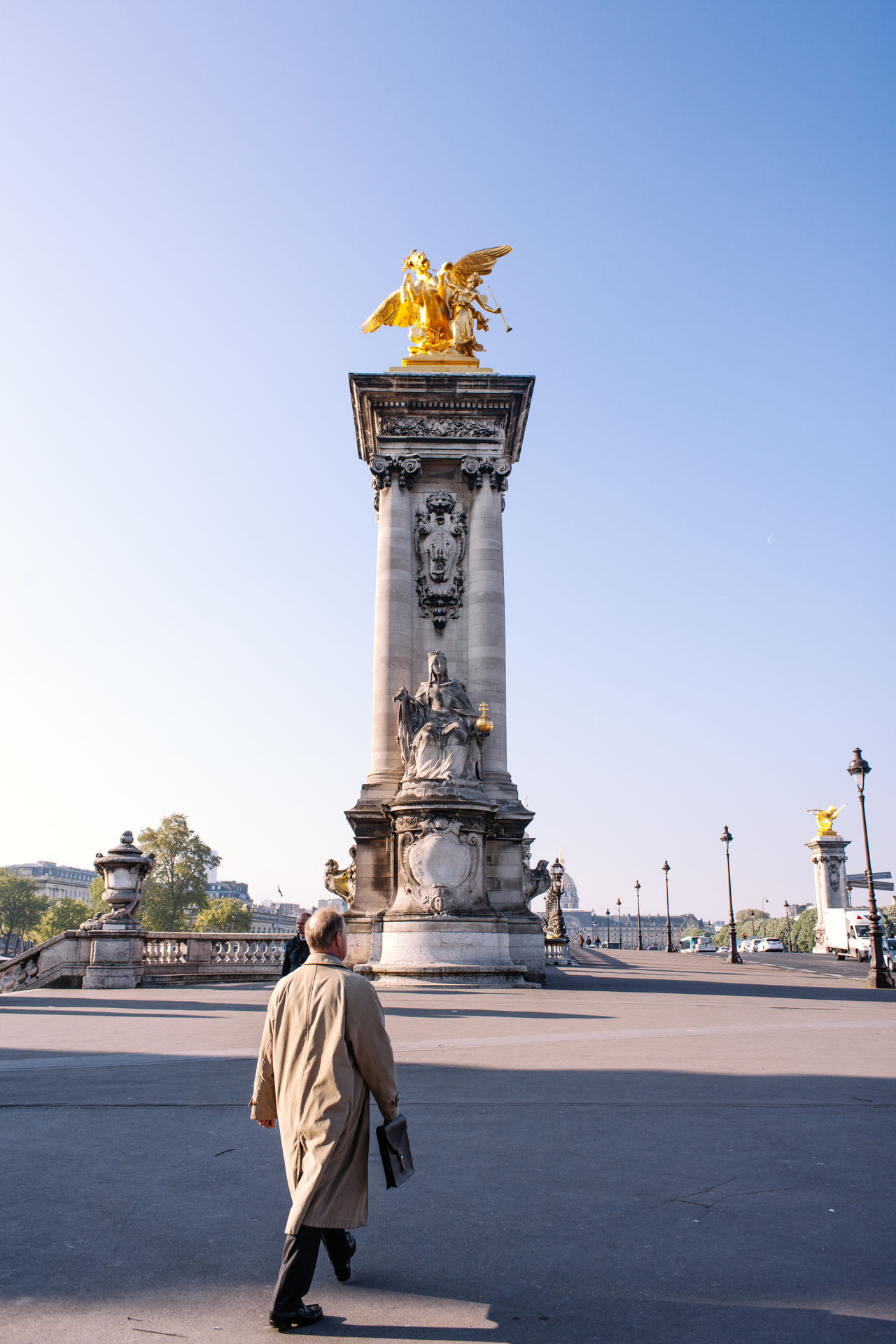 A man walking to Alexandre bridge Alexander Architecture Bridge City France Lifestyles Neighborhood Map Paris Sculpture Springtime Statue Travel Destinations Urban