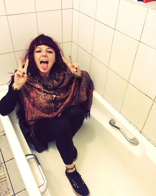 Person Tiled Floor Home Interior Bathroom Pic Bathtub Shenanigans Party Rock N Roll Fuckyeah Indoors  High Angle View Person Three Quarter Length Tiled Floor Looking At Camera Home Interior Casual Clothing Full Length Flooring Long Hair Young Adult Domestic Life
