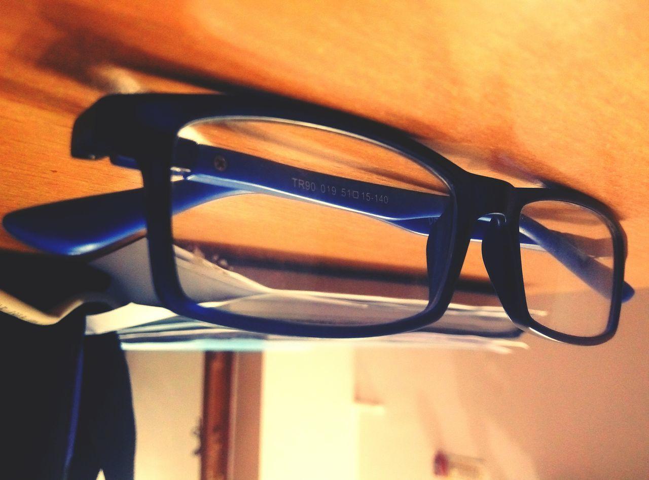 sunglasses, table, eyeglasses, no people, indoors, close-up, eyewear, eyesight, day