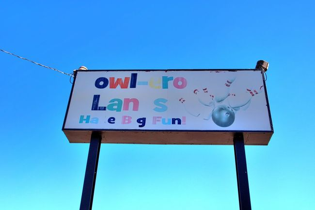 Abandoned Abandoned Buildings Abandoned Places Abandonedbuilding Blue Blue Sky Bowlero Lanes Bowling Alley Cable City City Life Clear Sky Communication Day Denver Colorado  Guidance Information Sign Low Angle View Multi Colored Old Signs Outdoors Pole Road Sign Text Western Script