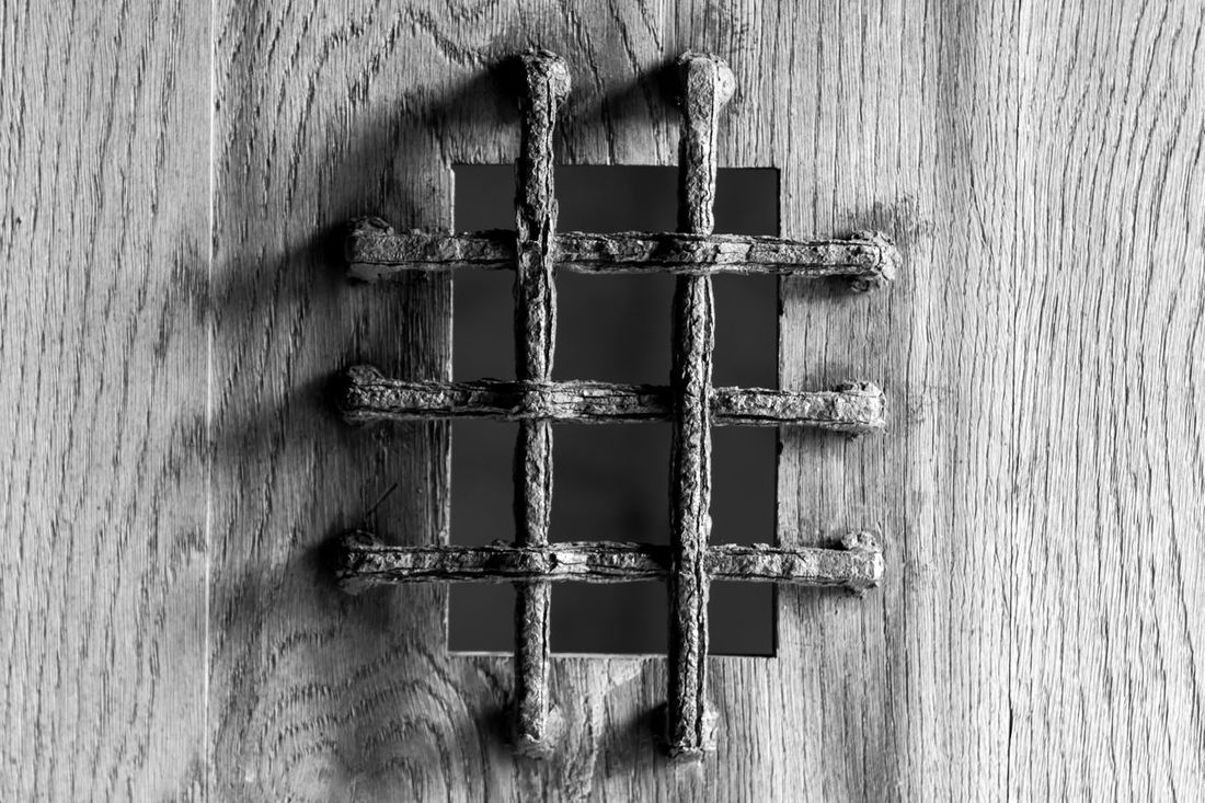 Isle of Mull, Scotland - metal bars on a small opening in a door, black and white Architecture Bars Black & White Blackandwhite Blackandwhite Photography Close-up Door Metal Monochrome Outdoor Photography Outdoors Scotland Wood - Material