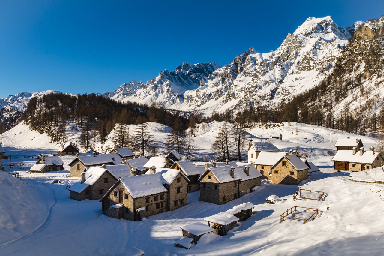 Beautiful village in the Alps Alpe_Devero Alps Beauty In Nature Chalet Crampiolo Landscape Landscape_Collection Landscape_photography Mountain Mountain Range Mountains Nature Nature Nature Photography Nature_collection No People Outdoors Rock Scenics Sky Snow Sunlight Village Village View Winter