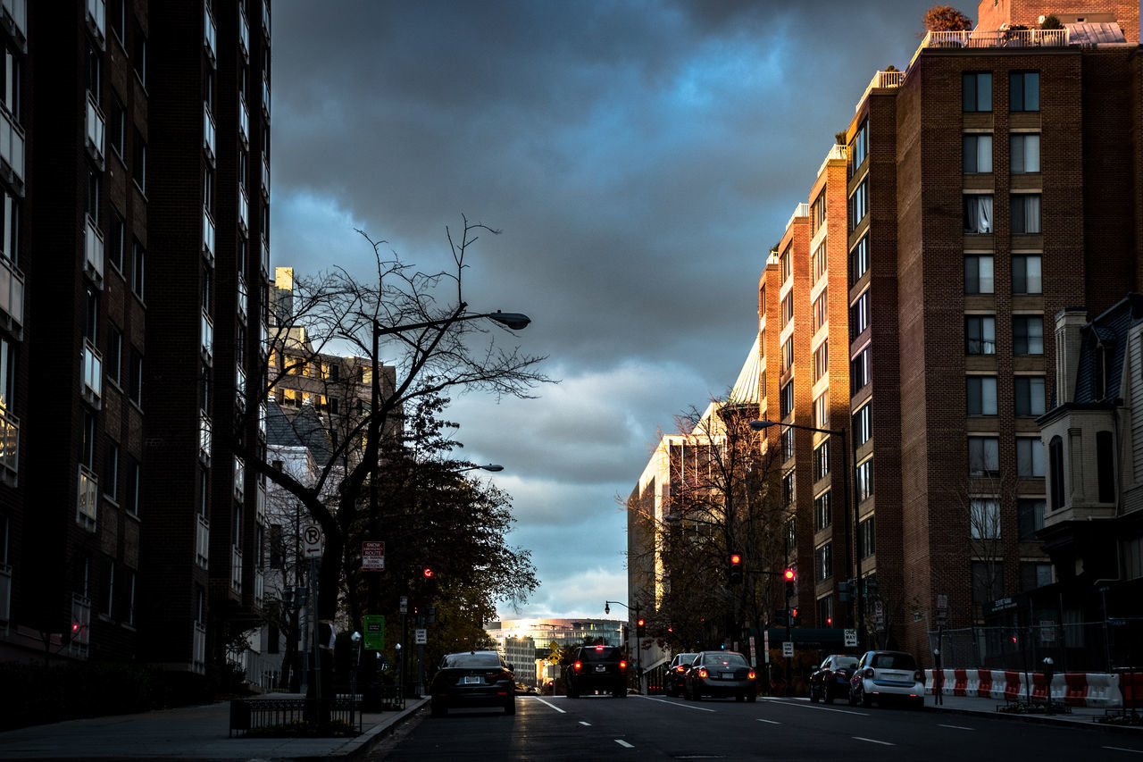 sky, architecture, building exterior, built structure, cloud - sky, car, land vehicle, outdoors, no people, city, day, tree