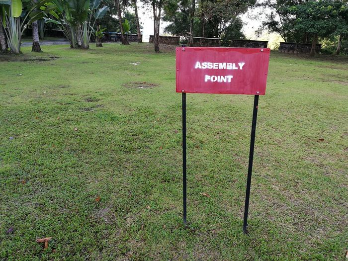 assembly point signage Assembly Point Signage Sign Fire Drill Safety Alert Safe Grass Text Green Color Communication Outdoors Day No People