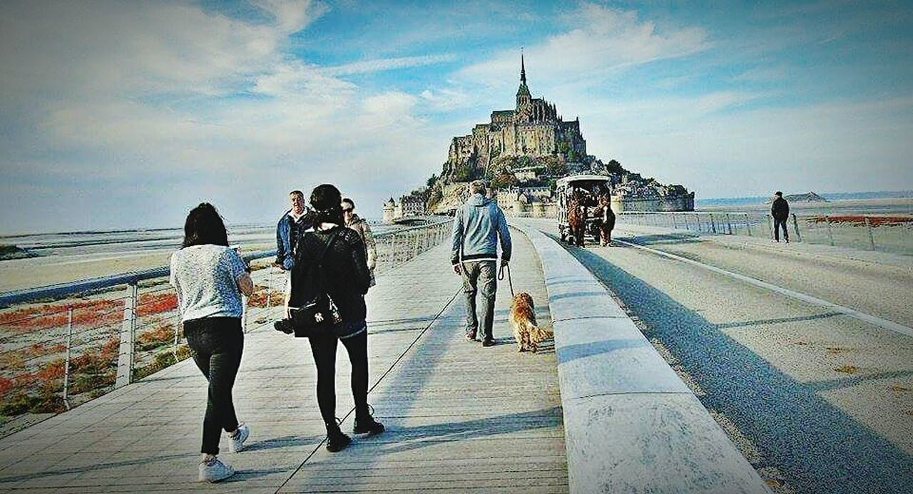 full length, rear view, sky, walking, cloud - sky, leisure activity, real people, women, built structure, architecture, day, outdoors, lifestyles, travel destinations, sea, vacations, adults only, building exterior, men, adult, large group of people, people, friendship, only women, city, young adult
