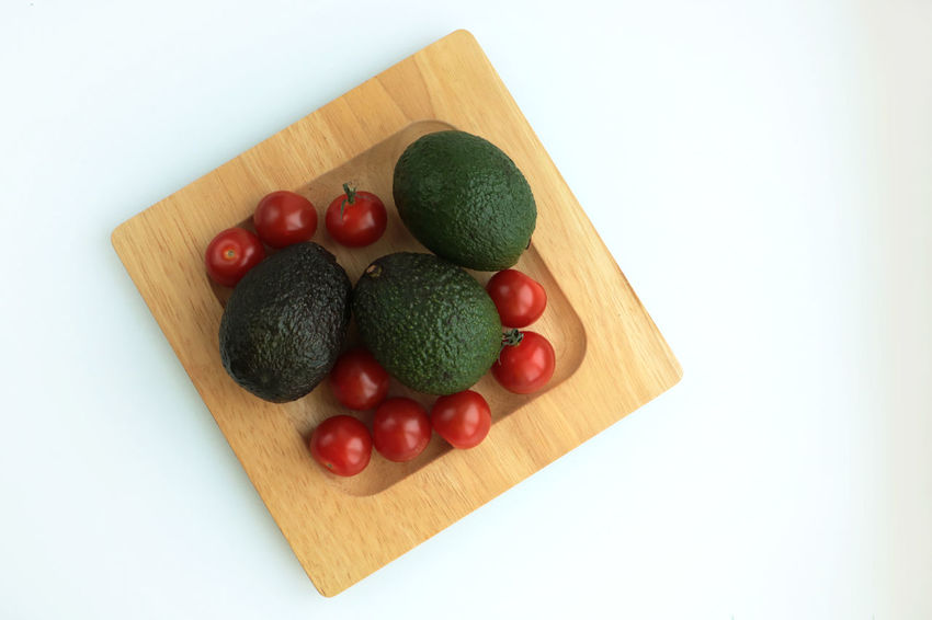 Avacado Close-up Cutting Board Day Food Food And Drink Freshness Fruit Healthy Eating Indoors  No People Plate Ready-to-eat Studio Shot Tomato Vegetable White Background Wood Wood - Material