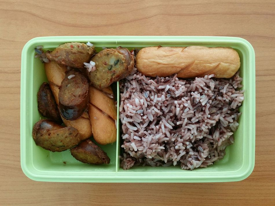 EyeEm Selects My Lunch Box with Brown Rice, North-Eastern styled Sausage of Thailand. Wood Background Plastic Green Color Partition Top View Of Food