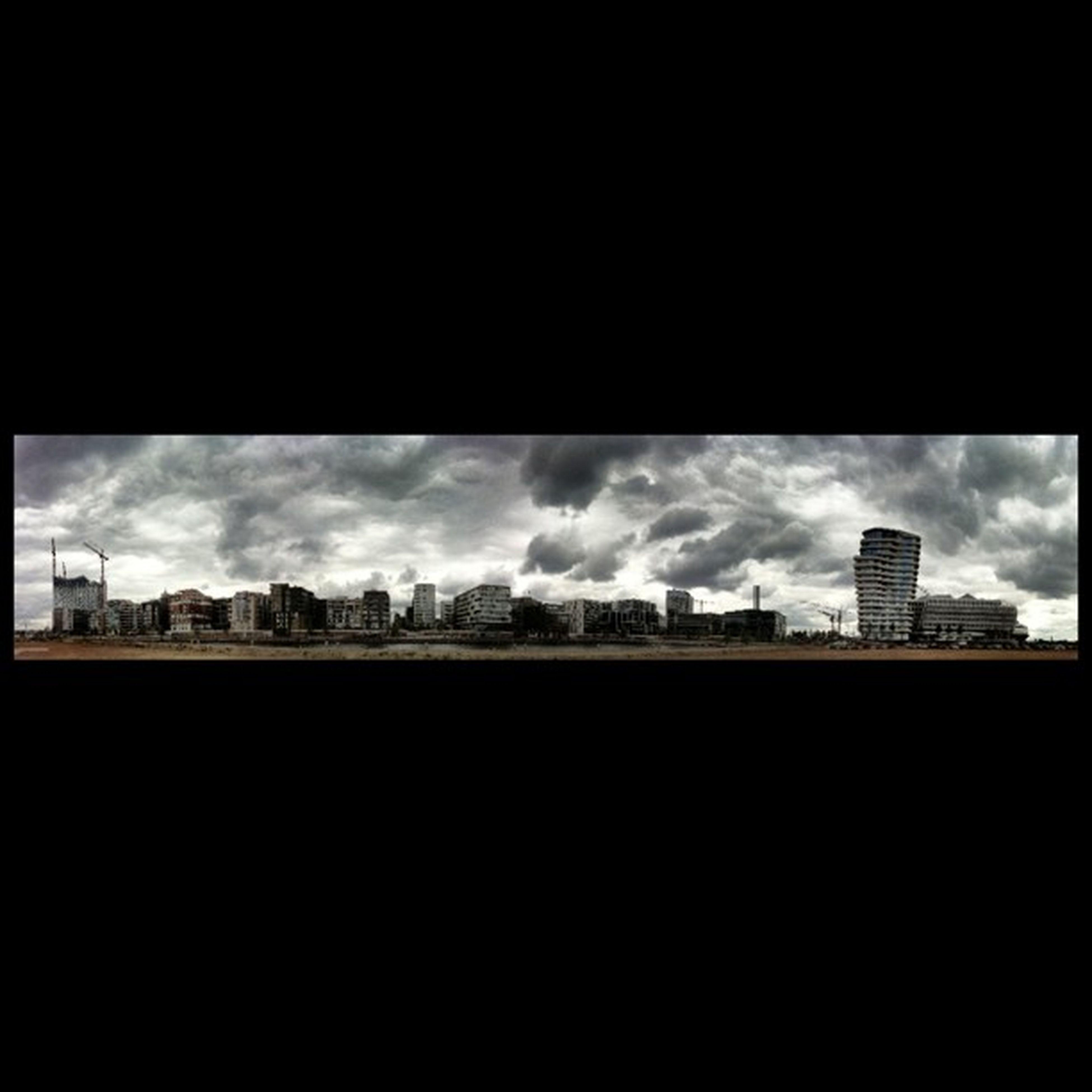 architecture, built structure, building exterior, silhouette, sky, city, copy space, dark, cityscape, residential structure, cloud - sky, building, window, residential building, cloud, no people, outdoors, dusk, house