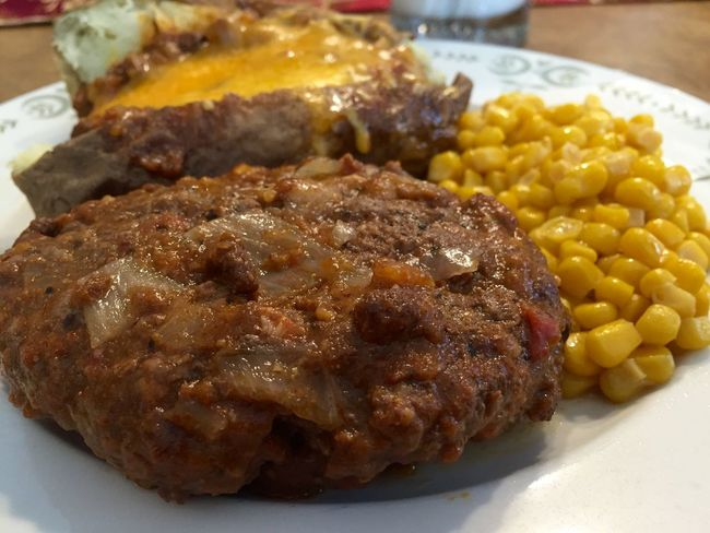 Hamburger Steak and baked potato covered with chili. Baked Baked Potato Cheese Chili  Close-up Corn Detail Focus On Foreground Food Freshness Hamburger Hamburger Steak Indulgence Meal Milk No People Potato Ready-to-eat Selective Focus Served Serving Size Snack Still Life Sweetcorn Temptation