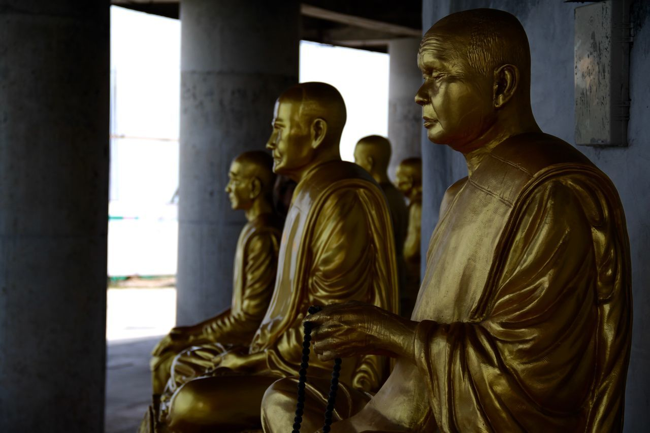 statue, male likeness, human representation, sculpture, art and craft, indoors, spirituality, religion, side view, gold colored, no people, day