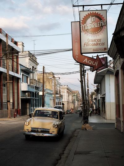 EyeEm Selects Architecture Built Structure Building Exterior Communication Car Cable Text City Outdoors Day Transportation Sky No People Cuba Cuba Collection Cuban Cars Cienfuegos, Cuba