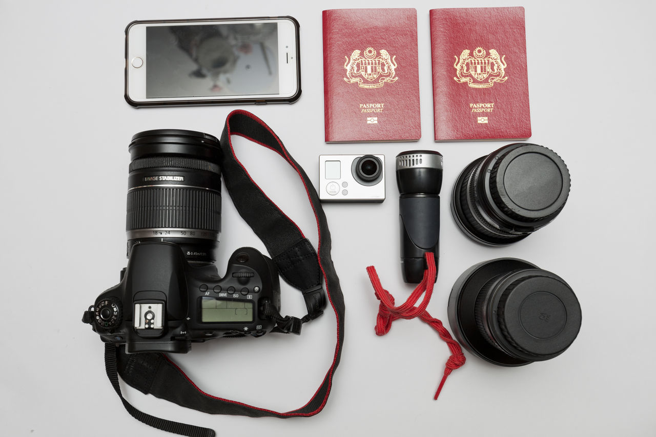 A view from the top of a collection of item to bring while travelling. Adventure Camera Collection Day Essential Flight Go Local Map No People Plan Plant Summer Tour Travel, Holidays Trip Variation View Weekend