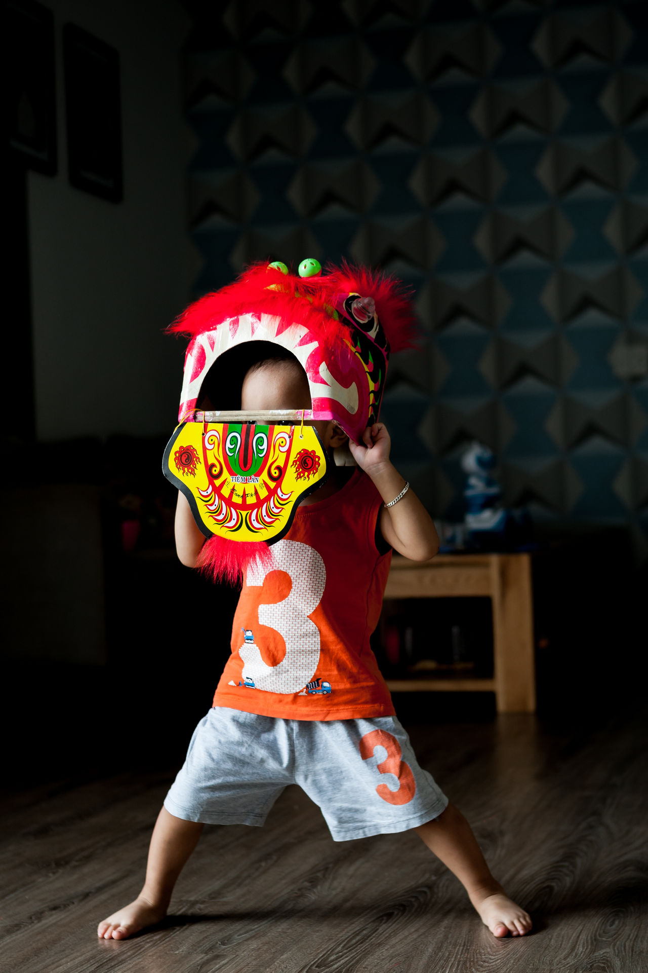 A kid is wearing a lion mask, dancing around his home, like the lion dance that he saw on Pagoda. Child Childhood Costume Dancing Full Length Fun Habit Indoors  Kids Playing Lion Dance One Person Performance Real People The Portraitist - 2017 EyeEm Awards EyeEmNewHere