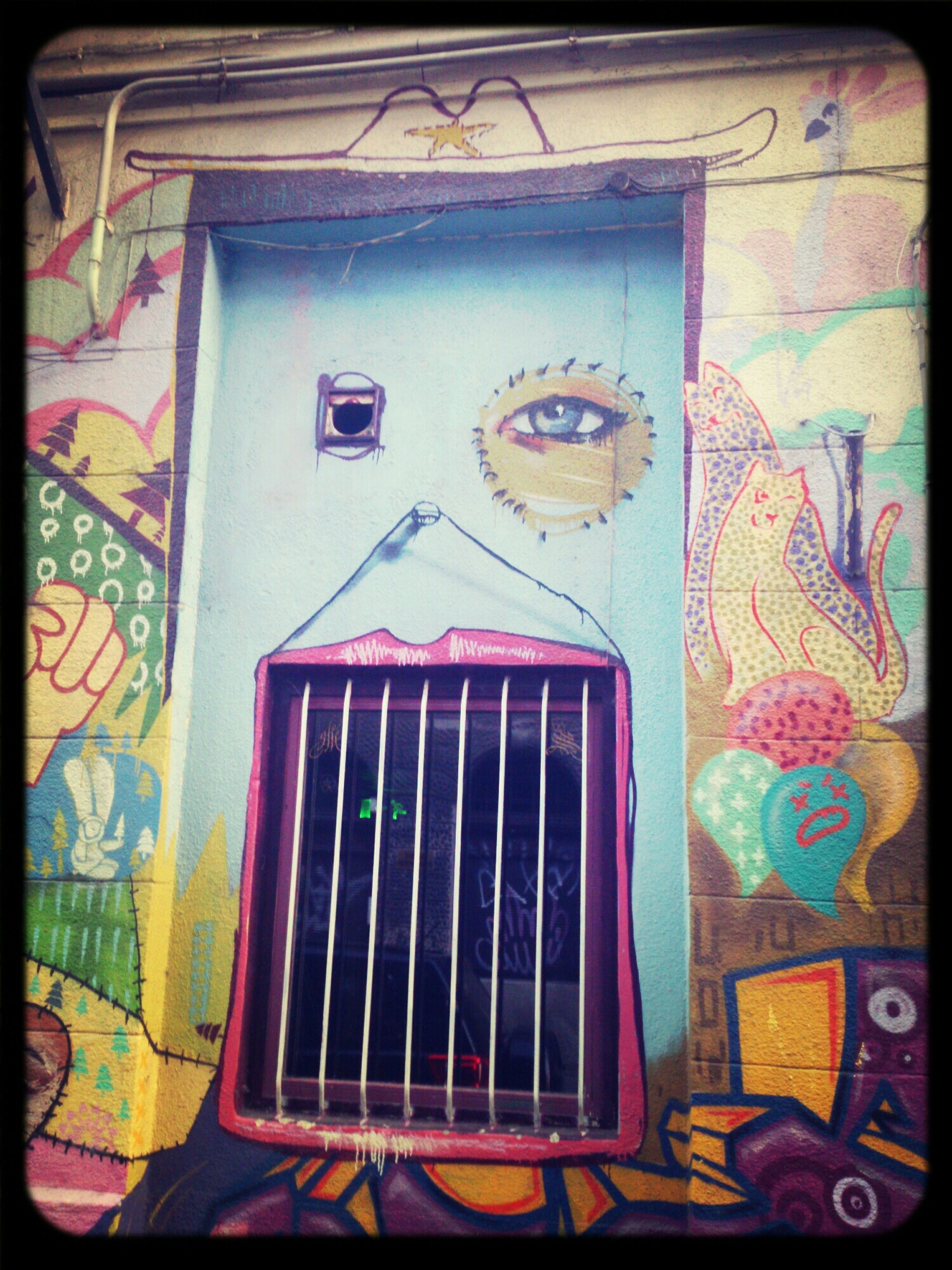 graffiti, art, art and craft, creativity, architecture, built structure, wall - building feature, building exterior, transfer print, multi colored, street art, auto post production filter, wall, door, mural, human representation, window, text, closed, design