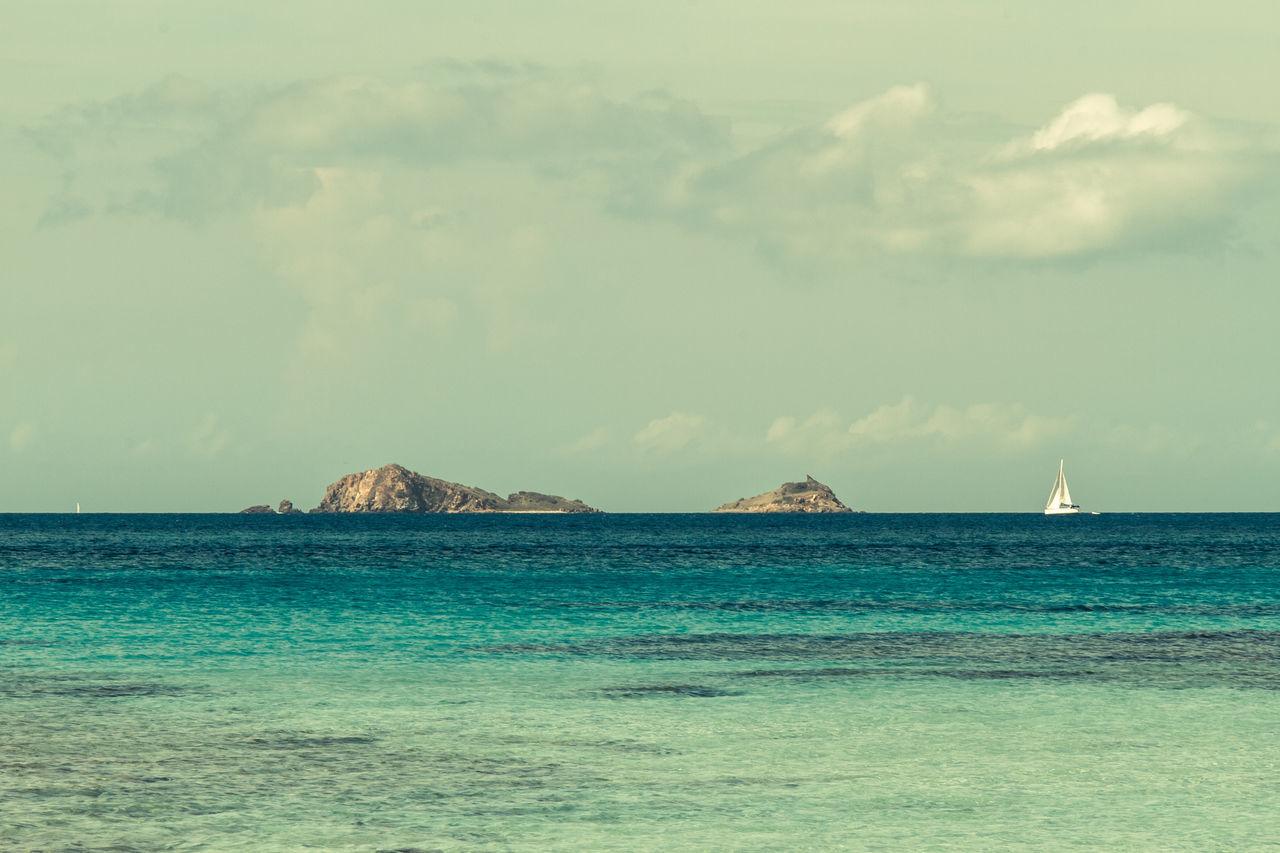 Blue Calm Caribbean Sea Clouds Horizon Horizon Over Water Ocean Outdoors Peaceful Relaxing Rock Sailboat Scenics Sea Seascape Sky Tranquil Scene Tranquility Tranquility Tropical Tropical Climate Vacation Vacations Virgin Gorda Water