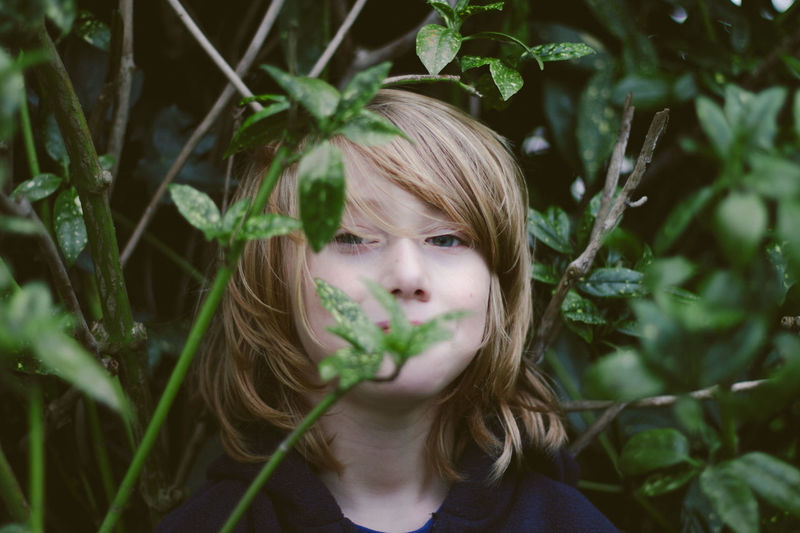 Little brother. Boy Youth Of Today Close-up Green Green Color Growth Innocence Leaf Person Plant Fine Art Photography The Portraitist - 2017 EyeEm Awards