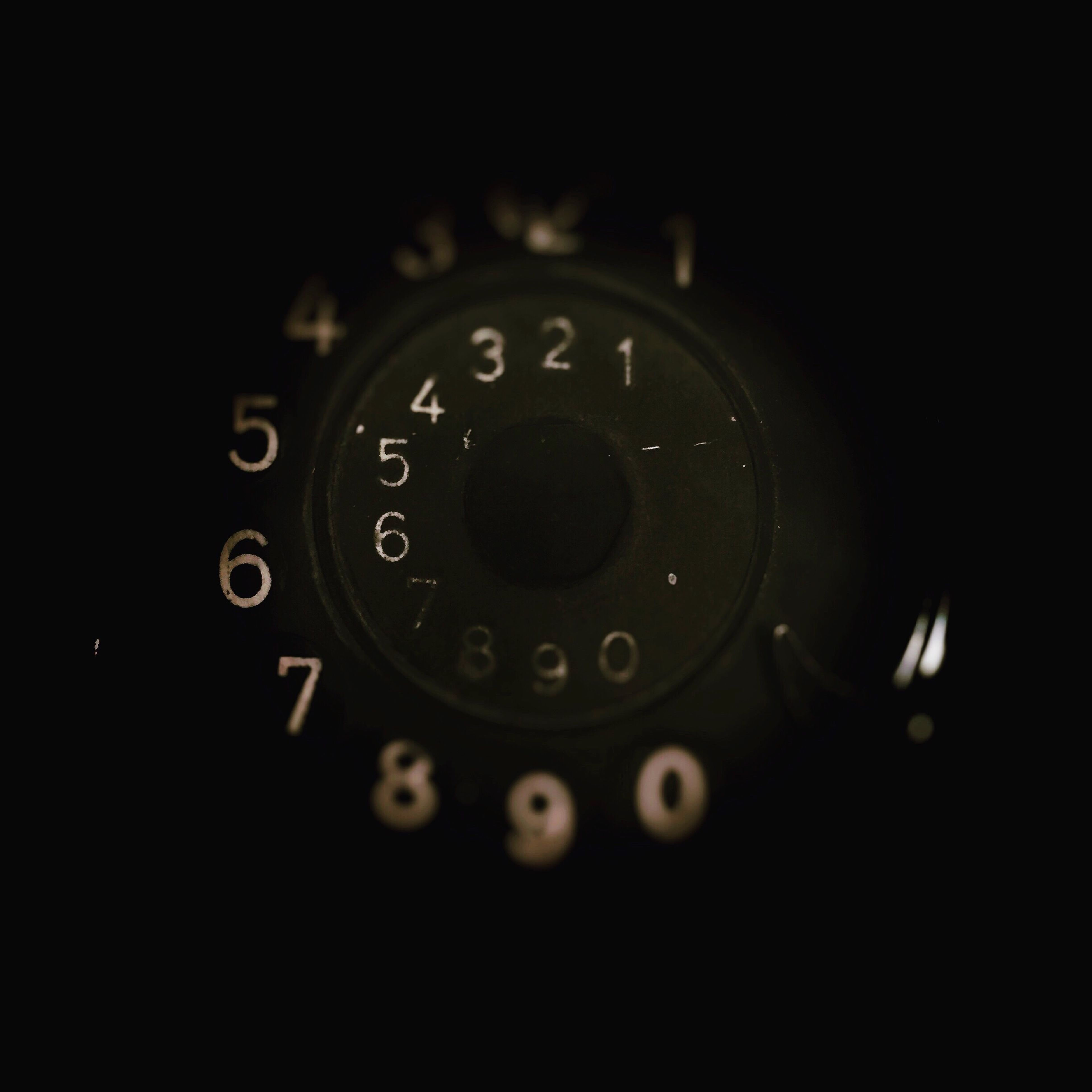 indoors, close-up, technology, old-fashioned, number, retro styled, clock, time, metal, circle, accuracy, old, connection, machine part, single object, antique, no people, camera - photographic equipment, lens - optical instrument, telephone
