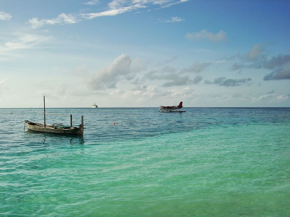 Horizon Over Water Transportation Travel Destinations Nautical Vessel Water Day Sky Sea Outdoors Sea Plane Maldives Variation Ocean Old To New Contrast Blue Sea Blue Sky Water Exotic Location Holiday Traditional Boat Cruise Ship
