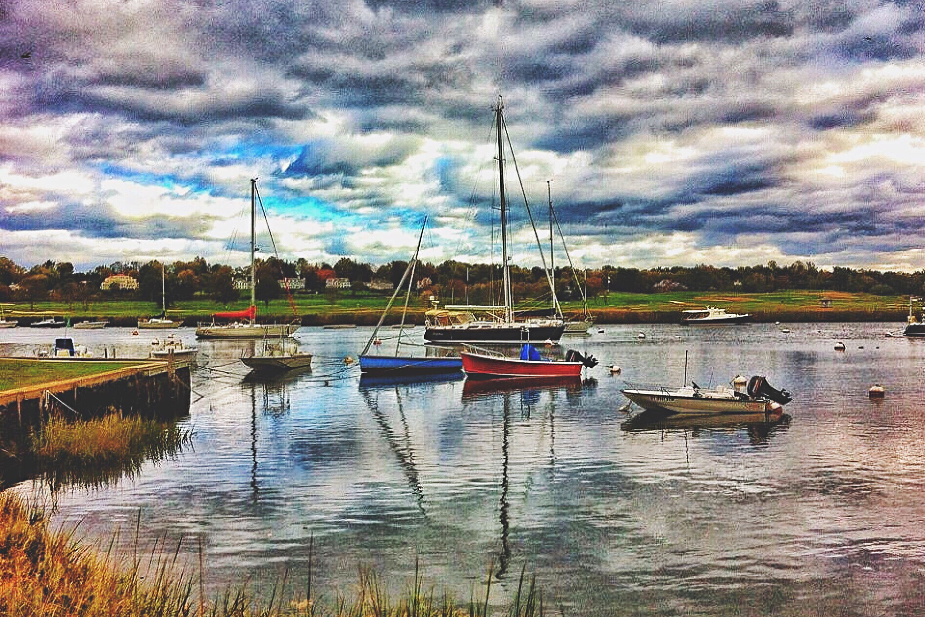 nautical vessel, transportation, water, boat, mode of transport, sky, cloud - sky, cloud, lake, sailboat, mast, cloudy, tranquility, tranquil scene, waterfront, calm, sea, scenics, day, nature, outdoors, dramatic sky, no people, beauty in nature, harbor, tourism, mountain, cloudscape