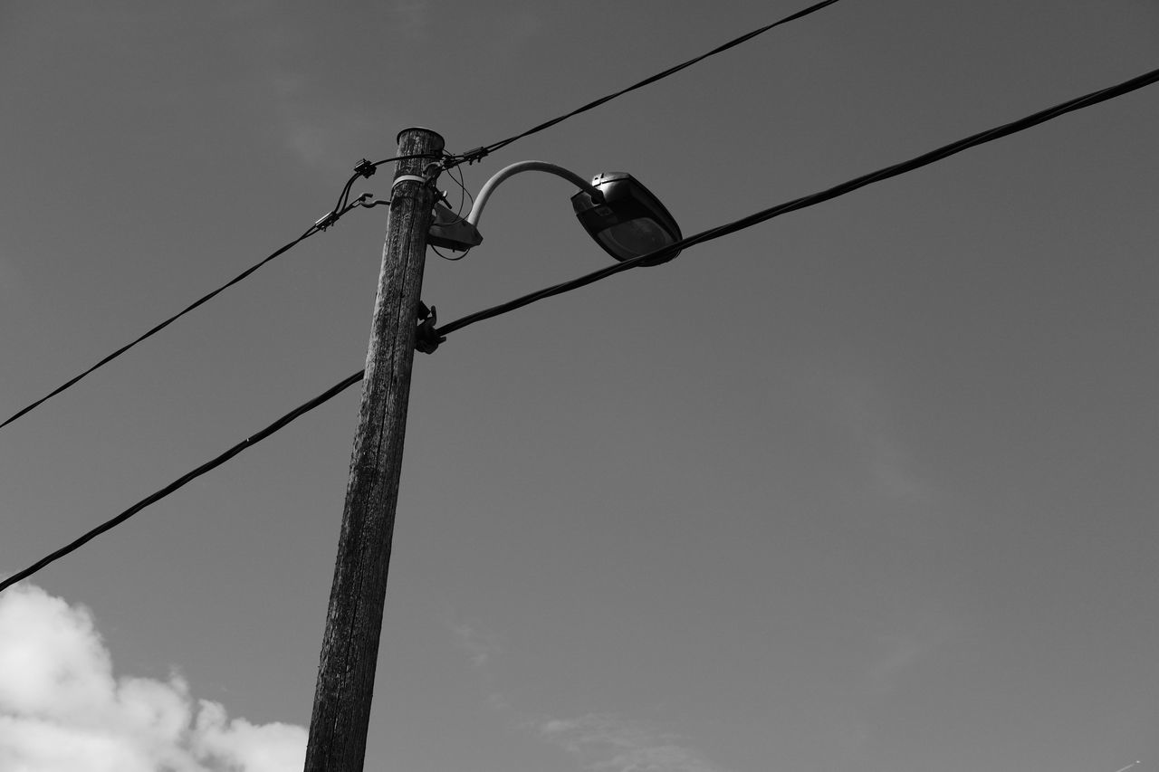Blackandwhite Cable Cloud Connection Day Electric Pole Electricity  EyeEm Best Shots Lighting Equipment Low Angle View Monochrome No People Outdoors Power Line  Power Supply Sky Street Light Technology Telephone Line
