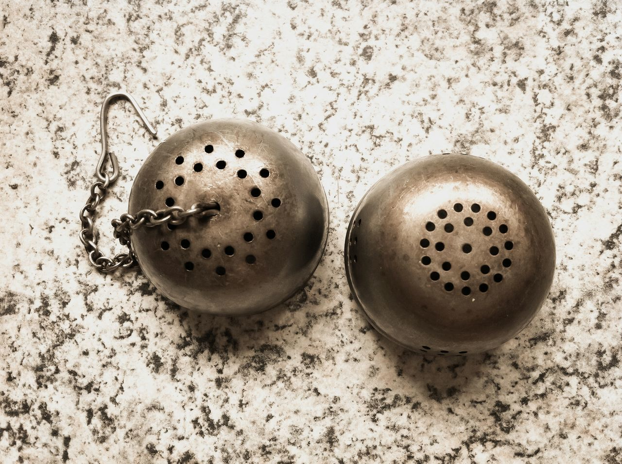 High Angle View Of Tea Strainer On Kitchen Counter