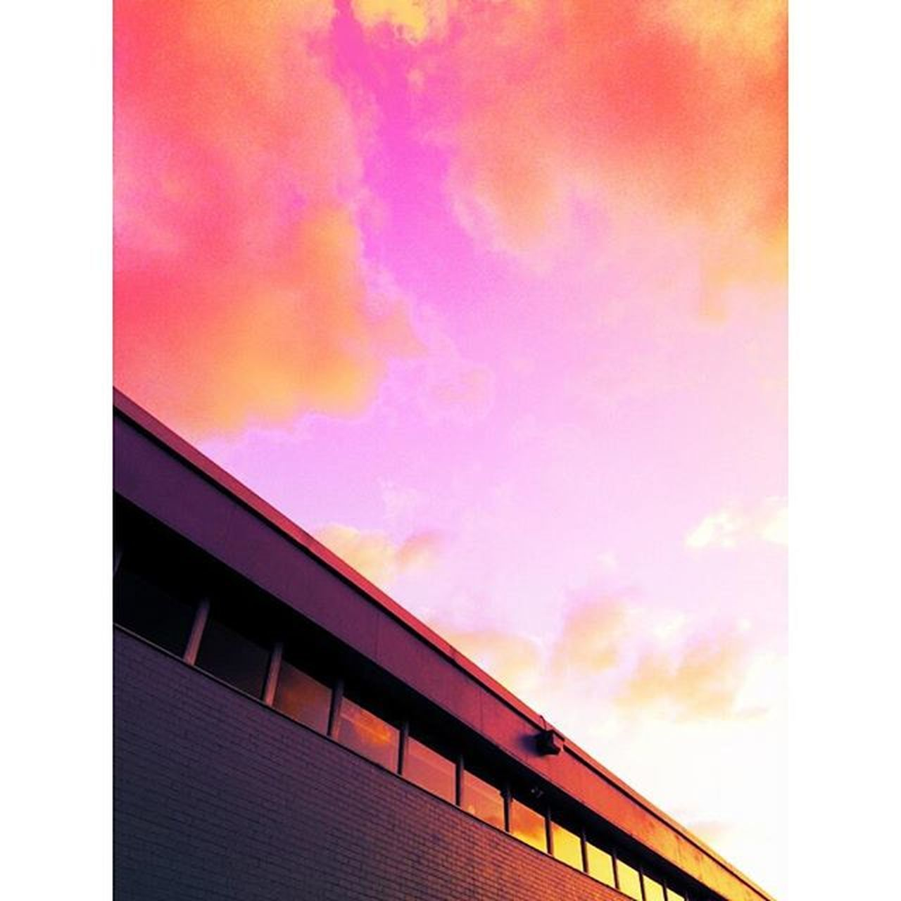 transfer print, sky, auto post production filter, architecture, built structure, low angle view, building exterior, cloud - sky, sunset, cloudy, orange color, cloud, outdoors, no people, overcast, building, high section, multi colored, dusk, nature