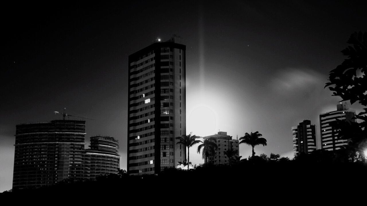 architecture, skyscraper, building exterior, low angle view, built structure, modern, sky, city, no people, night, apartment, outdoors
