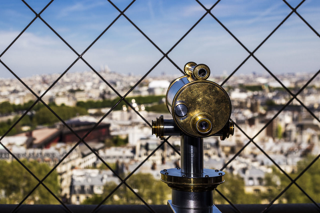 Architecture Architecture_collection Building Exterior City Cityscape Close-up Coin-operated Binoculars Day Eiffel Famous Place Focus On Foreground Metal No People Outdoors Paris Paris, France  Sky Technology The Architect - 2017 EyeEm Awards Tourism Destination Tourist Attraction