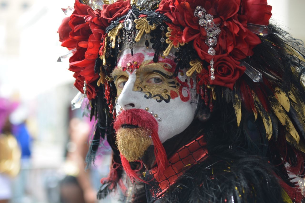 One of the best costume and make up in the San Francisco 2017 Carnaval Mask - Disguise Venetian Mask Carnival Red Tradition Celebration Arts Culture And Entertainment Day Disguise Outdoors No People Close-up Clown Carnival Crowds And Details Carnaval 2017 The Street Photographer - 2017 EyeEm Awards Headdress Event BYOPaper!