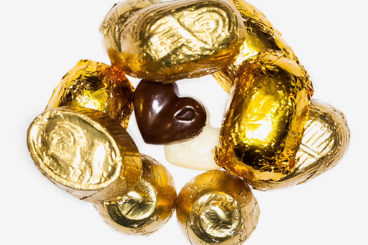Close Up Of Chocolate Pieces Covered With Golden Aluminum Foil Aluminium Foil Black And White Chocolate Close-up Concept Diet Foil  Gold Gold Colored Heart Love Luxury Melting No People Shiny Shiny Silver  Studio Shot Sugar Sweet Two Hearts Unhealthy Eating Valentine's Day  White Background White Backround