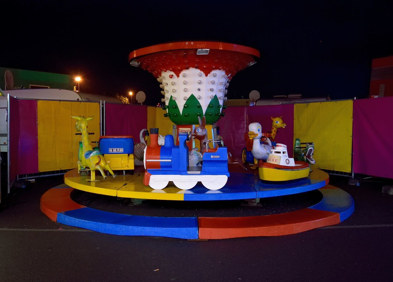 A Movable Amusement Park in Leipzig Amusement Park At Night Amusement Parks Amusement Ride Architecture Darkart Darkness Illuminated No People Nofilter Outdoors Silence