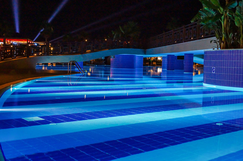 Pool Architecture Blue Illuminated Luxury Modern Night No People Outdoors Railing Reflection Steps Swimming Pool Water
