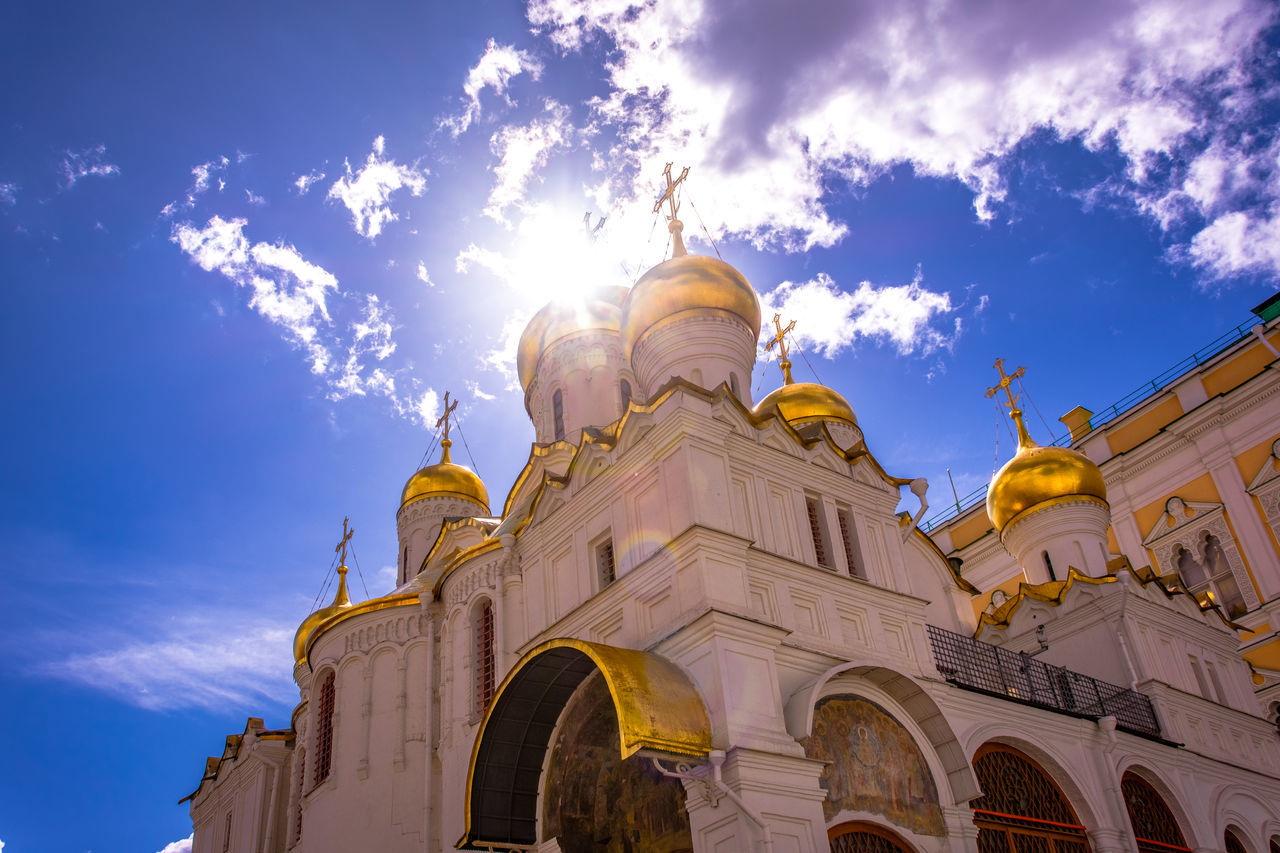 low angle view, religion, spirituality, sky, architecture, cloud - sky, building exterior, built structure, place of worship, sunlight, no people, day, outdoors