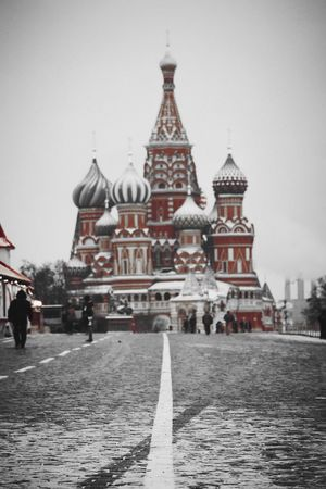 Built Structure Travel Destinations Travel Architecture Building Exterior Place Of Worship City Religion Tower Spirituality Outdoors Day People One Person Snowing Winter Moscow, Москва Russia россия красная площадь Red Square St Basil's Cathedral City Life Snow Cloud - Sky Coldday