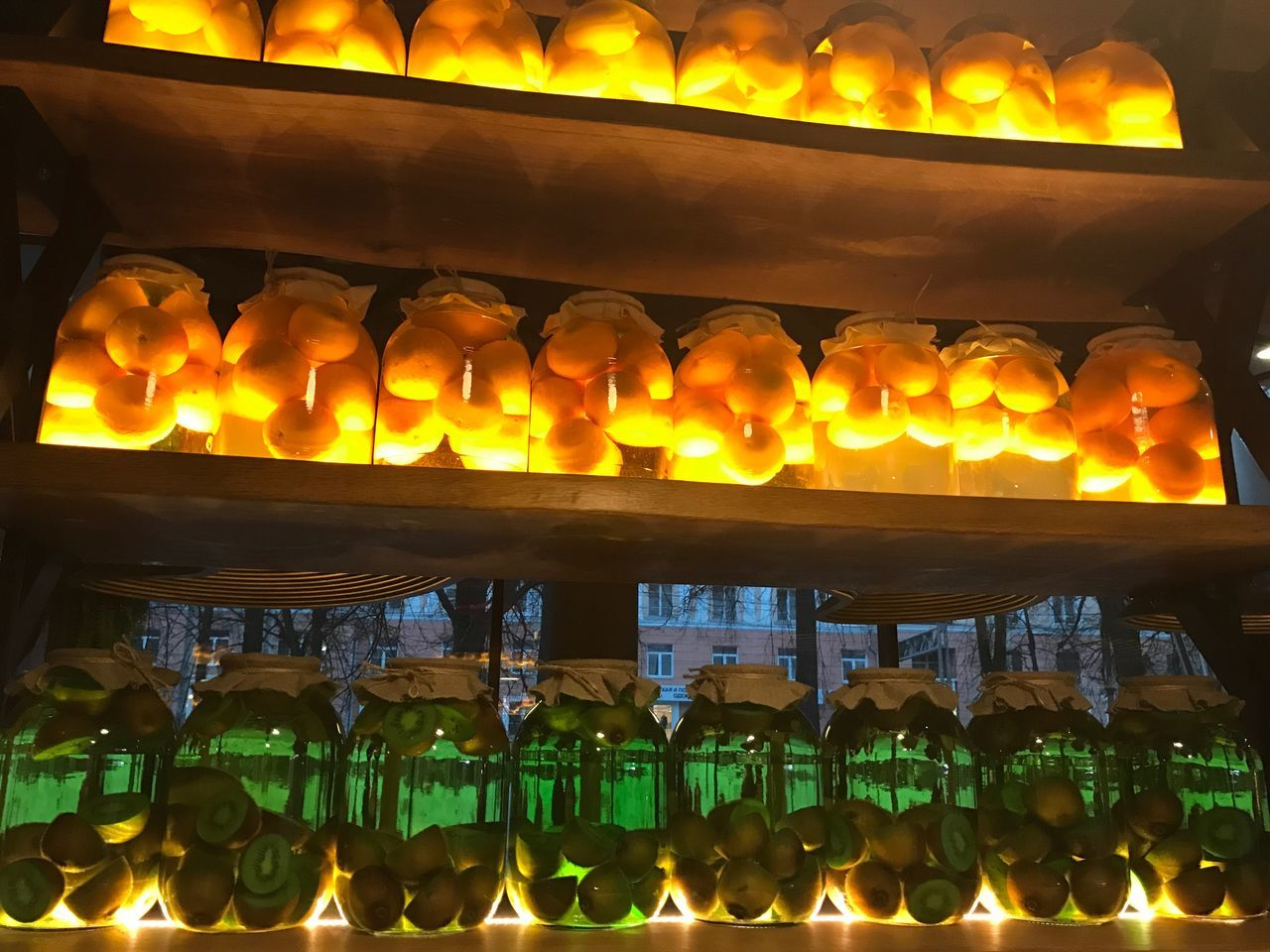 illuminated, in a row, indoors, burning, flame, glowing, night, large group of objects, no people, food and drink, heat - temperature, shelf, food, close-up