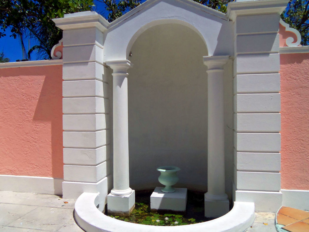 Empty alcove with planter in the wall Alcoves Arch Architectural Features Architecture Architecture Architecture Details Building Exterior Built Structure Day Flushing Toilet No People Ornate Outdoors Pillars Pillars Support Planter Sculpture Statue Stone Wall Tropical Architecture White Color