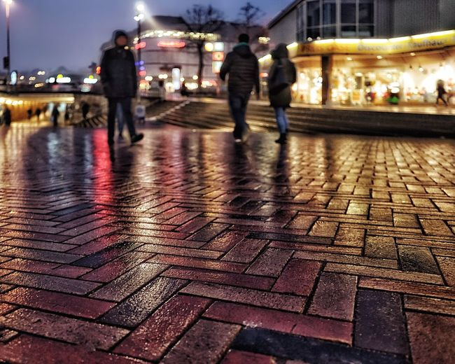 Real People Lifestyles Walking Illuminated Men Night Large Group Of People Women Leisure Activity Built Structure Outdoors Architecture Togetherness City Building Exterior Close-up Sky Adult People Adults Only City Wet Street After The Rain Reflection Brick Street