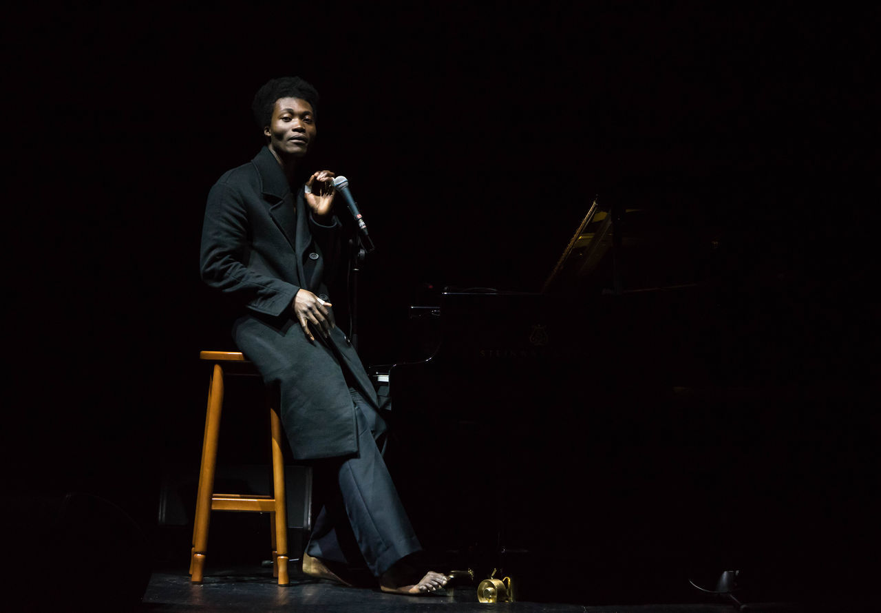 Performance of Benjamin Clementine in Kiev Ukraine Benjamin Clementine Casual Clothing Confidence  Dark Full Length Handsome Hi Leisure Activity Lifestyles Low Angle View Night One Mid Adult Man Only Perform Performance Person Profile S Standing Well-dressed Young Adult Young Men