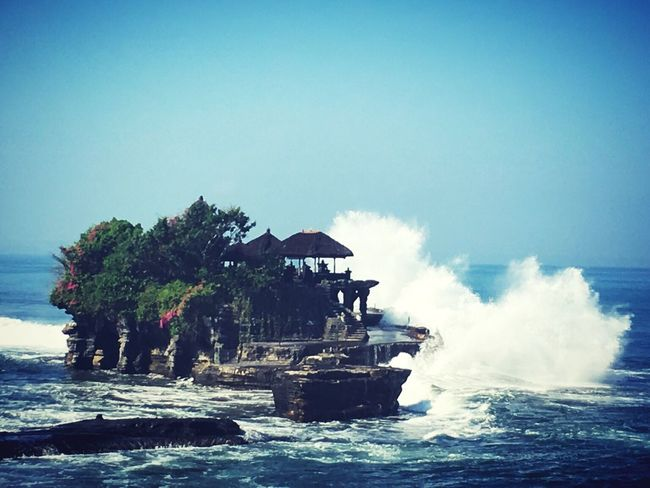 Stand tall even when it hit you Sea Wave Surf Water Blue Tourism Travel Destinations Power In Nature Waterfront Vacations Nature Non-urban Scene Breaking Coastal Feature Geology Scenics Beauty In Nature Sky Day Crash Tanah Lot Bali, Indonesia