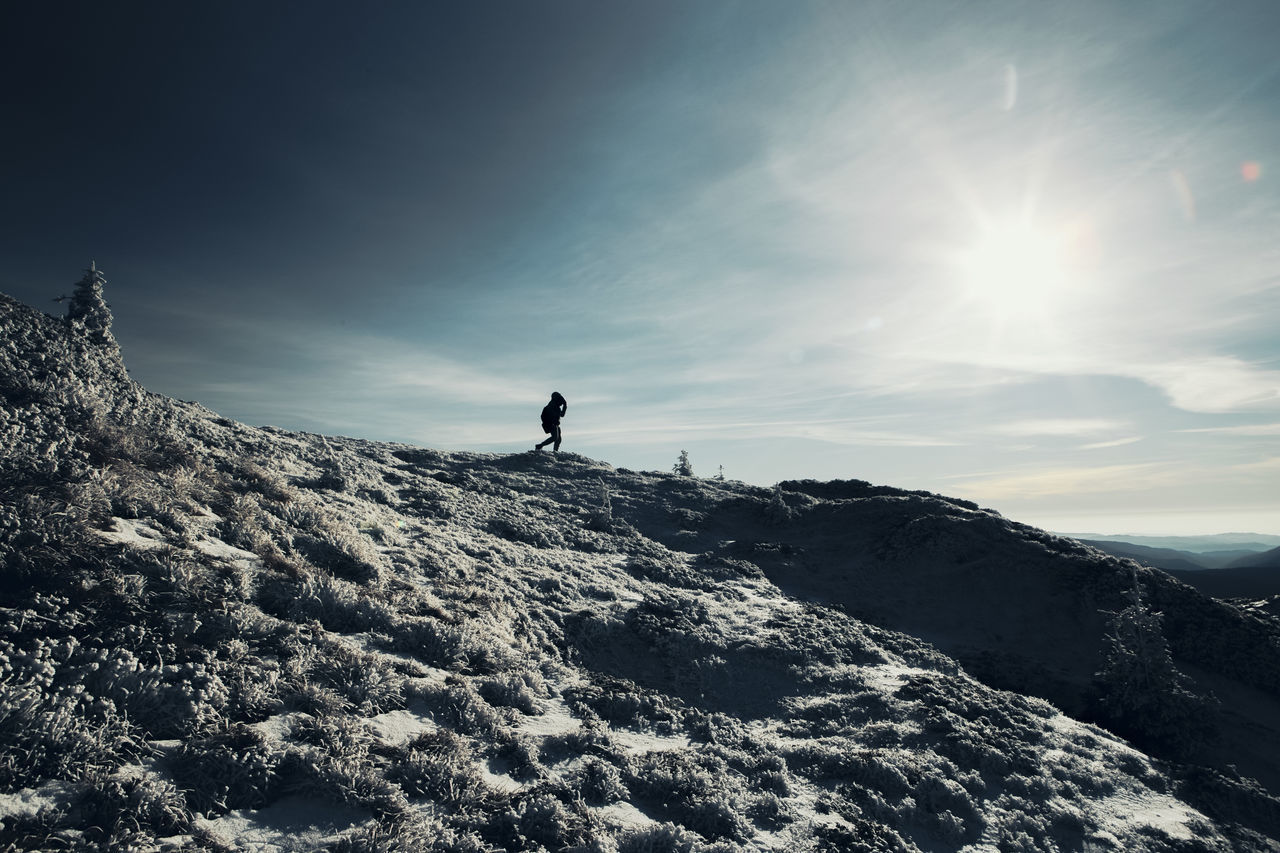 Adult Adults Only Adventure Cold Temperature Day Exploring Full Length Hiking Landscape Leisure Activity Mountain Nature One Man Only One Person Only Men Outdoors People Scenics Silhouette Sky Snow Sun Sunlight Warm Clothing Winter