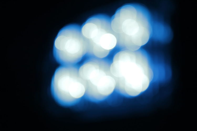 """Blurred blue emergency light of the """"LiMa"""" Abstract Black Background Blue Light Blur Blurred Lights Blurred Visions Defocused Emergency Light German Federal Agency For Technical Relief Light Effect Night Night Lights No People Outdoors THW THW Markt Schwaben"""