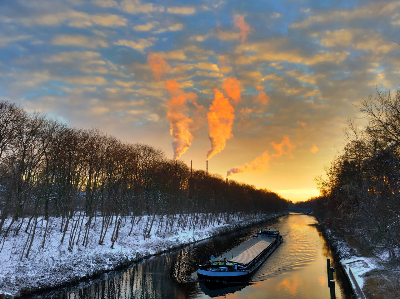 Teltow canal at sunset Artificial Watercourse Bulk Carrier Canal Cargo Ship Carrier Chimney Chimneys Freighter Navigation Reflections Reflections In The Water Ship Shipping  Sky Sky And Clouds Smokestack Smokestacks Snow Snow ❄ Sun Sundown Sunset Sunshine Transport Transport Ship