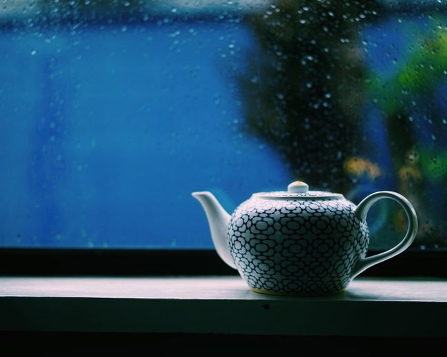 Rain & Tea // Food And Drink Refreshment Drink Window Still Life Glass - Material Transparent Close-up Coffee - Drink Indoors  Coffee Cup Water Window Sill Freshness Railing Focus On Foreground Kitchen Utensil Non-alcoholic Beverage Blue Unhealthy Eating