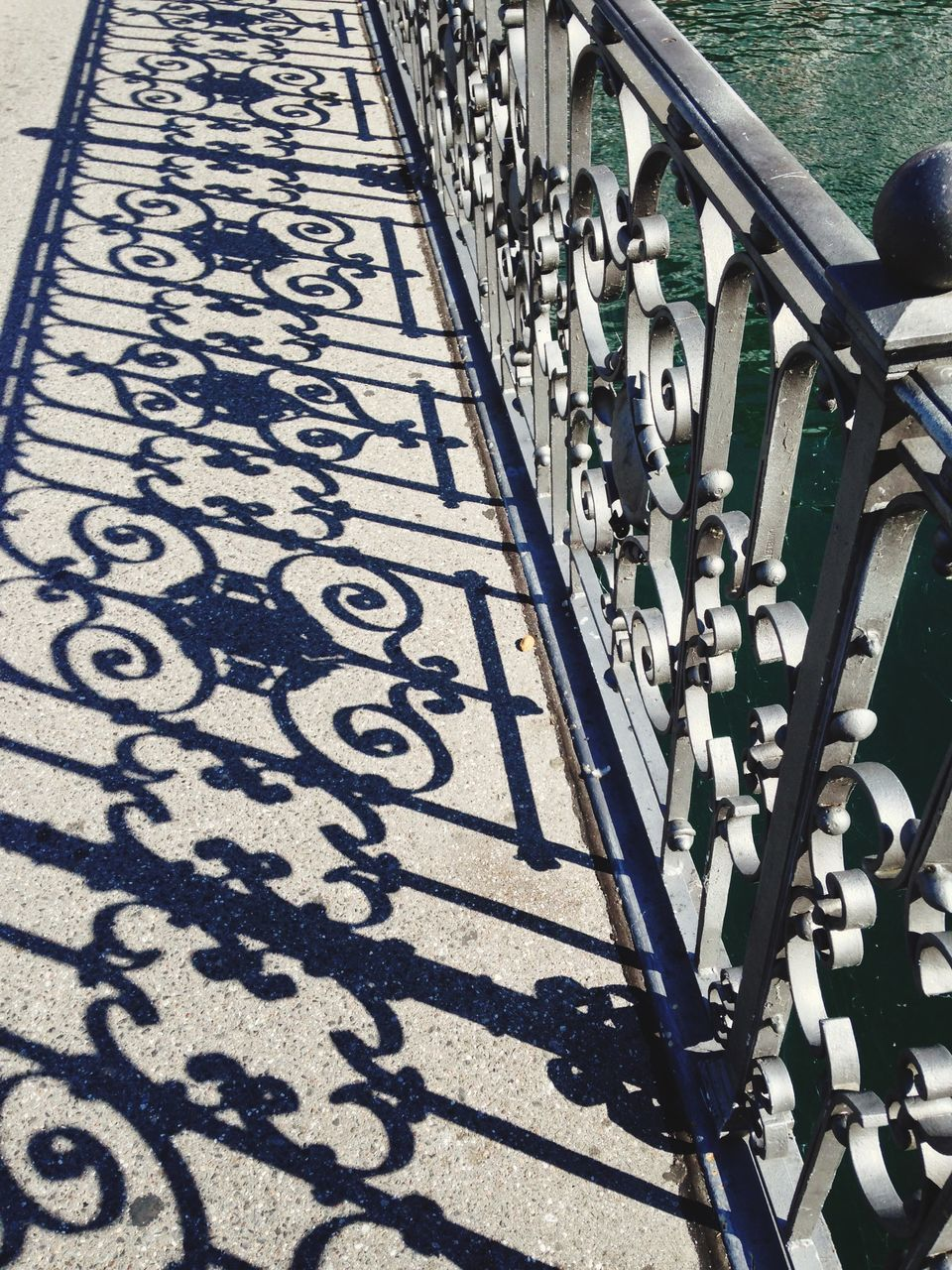 railing, high angle view, shadow, sunlight, day, outdoors, no people, hand rail, close-up