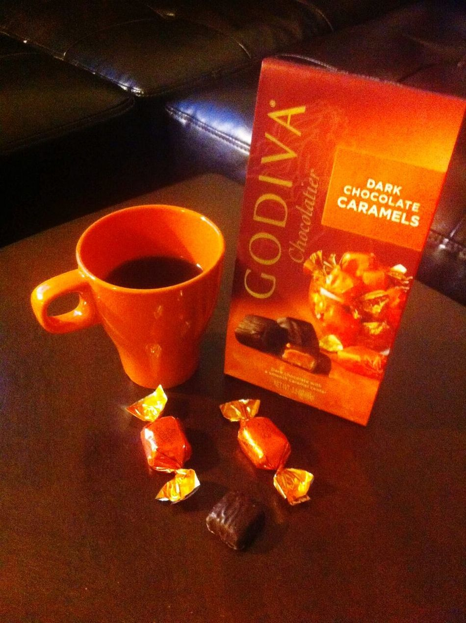 Food And Drink Indoors  Drink Coffee At Home Coffeetime Coffee Coffee Time Coffeeaddict Chocolate Chocolate♡ Chocolate Time Godiva Chocolate Godiva Chocolate Café Godivachocolate Orange Colour