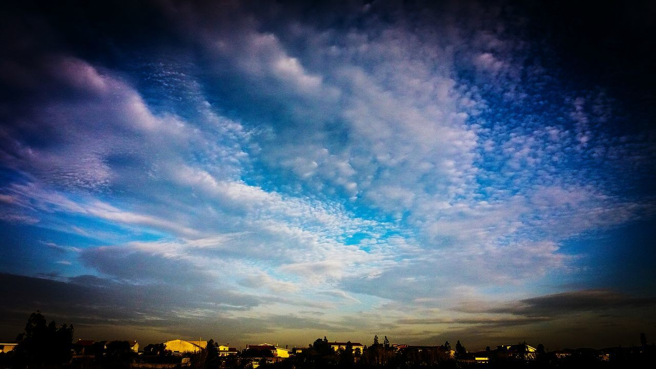 sky, cloud - sky, blue, scenics, beauty in nature, low angle view, no people, dramatic sky, nature, outdoors, building exterior, tranquility, tranquil scene, built structure, architecture, sunset, cityscape, day