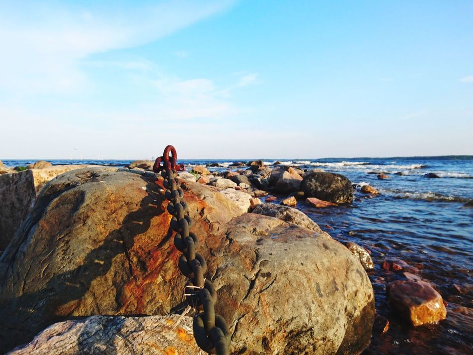 Sea Horizon Over Water Water Sky Beach Scenics Beauty In Nature Nature Rock - Object Day Tranquility One Person Outdoors Wave Chain Rusty Finding New Frontiers Still Life