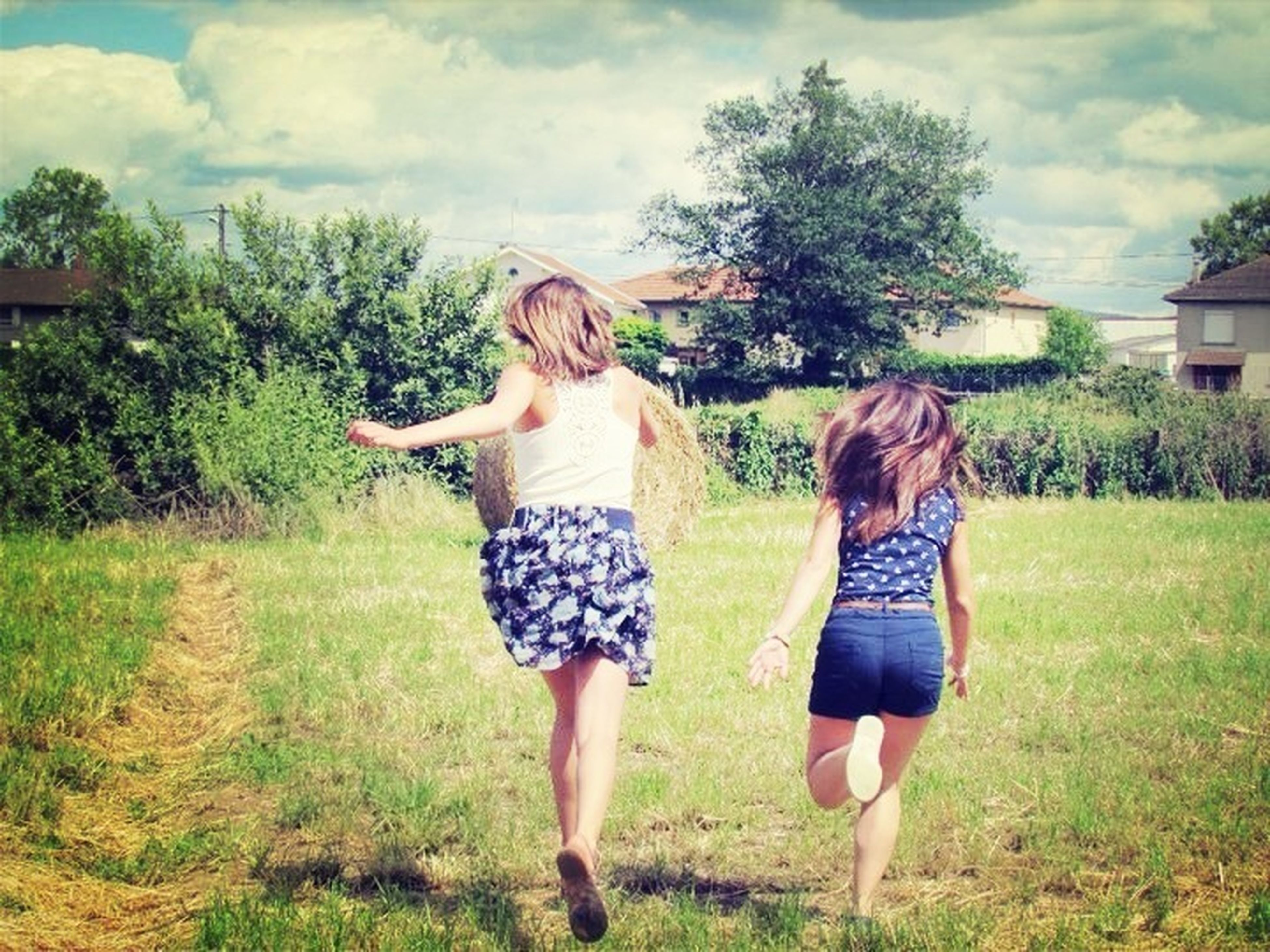 grass, lifestyles, casual clothing, full length, leisure activity, sky, person, young adult, standing, tree, field, young women, cloud - sky, childhood, girls, grassy, front view, three quarter length