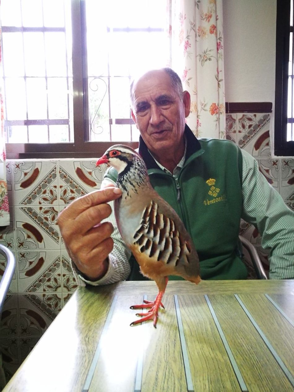 My father with his pet.🐦😅😁