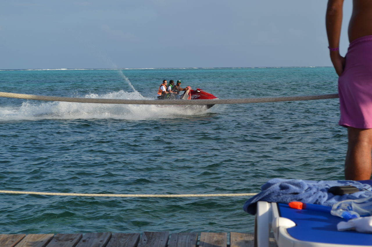 Adult Adults Only Adventure Astrology Sign Day Horizon Over Water Jet Boat Jetski Jetskiing Jetsky Life Jacket Motion Nautical Vessel Outdoors People Sea Teamwork Togetherness Transportation Young Adult